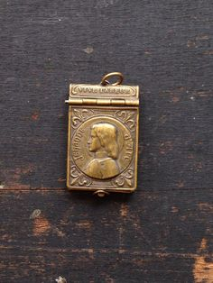 Beautiful engraved photo locket with working clasp by French master engraver Emille Dropsy. The pendant is signed E. Dropsy. Inside the locket is a 9