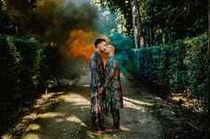 Vibrant wedding fashion, fusion of cultures, and abundant joy—you don't want to miss out on this jaw-dropping multicultural celebration!    Image by Carlos Elizondo Wedding Blog, Wedding Styles, Our Wedding, Unique Wedding Colors, Unique Weddings, Colors And Emotions, Colored Smoke, Groom Looks, Bridezilla