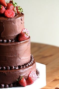 on this i like the chocolate button/blob detailing around the bottom of each layer.  i would prefer the tiers all be the same height though, and i like the kind of cakes where the layers are stacked directly on top of each other