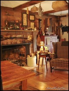 Love this whole setting:  the rifle on the lintel, the crocks, the chair, the walls, the baskets, the hang-drying Artemesia!  Only one thing it needs ~ a fire in the hearth!