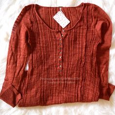 """FREE PEOPLE Tunic Ribbed Henley Sweater Pullover Size Large. New with tags. $98 Retail + Tax.  Sheer ribbed pullover top with a low scoop neck and optional buttons.  Comfortable & slightly stretchy. Cotton, nylon.   Measurements for Large: Bust: 37"""" Length: 30"""" Sleeve: 24.5""""   ❗️ Please - no trades, PP, holds, or Modeling.    Bundle 2+ items for a 20% discount!    Stop by my closet for even more items from this brand!  ✔️ Items are priced to sell, however reasonable offers will be considered…"""