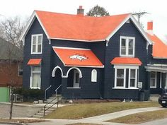 Deep in the heart of Packers Country, sits a home that doesn't fit in. Coated not in Packers green and gold, but in orange and blue, complete with a Denver Broncos logo on the roof.