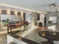 The old and the new. Antique and vintage pieces - a screen here, chandelier there - add warmth and texture to @zaborin.ryokan concrete reception area.  #zaborin #ryokan #niseko #hokkaido #hotel #hoteldesign #design #details #designdeinteriores #interior #interiordesign #minimalism #antique #zen #visitjapan #travel #wanderlust #keepicks |zaborin.com