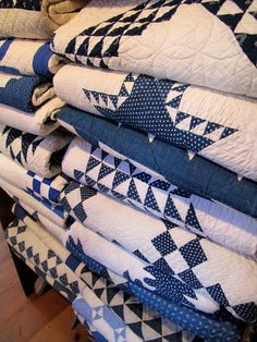 We all need a stack of beautiful blue and white antique quilts!