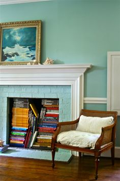 Not the color, but LOVE the books in the fireplace!  Ideas of what to do with my improperly vented foreplace!