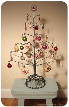 I love this wire tree with wooden button ornaments. I am feeling all Christmasy right now.
