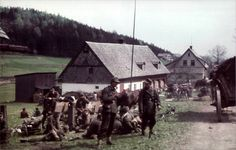 The pictures were taken May 8, 1945, during the retreat of the 6th Infantry Division of the Wehrmacht in the Neustadt in Tafelfichte in the Ore Mountains (Bohemia, modern Nové Město pod Smrkem, Czechoslovakia) and the Giant Mountains (Riesengebirge, Silesia, Czechoslovakia). Photos were captured German soldier, who was still Agfa color film in his camera.