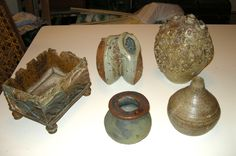 Andrew Hague seed pot and a large multi holed vase by Aller? Pottery. The others unknown