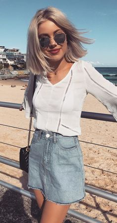 2d696fb9d7c  winter  outfits white v-neck long-sleeve crop top and blue washed