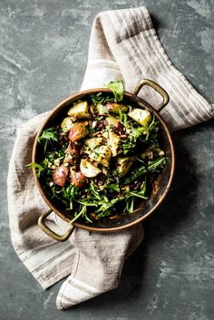 GARLICKY ROASTED POTATOES WITH WILTED GREENS & BACON GREMOLATA