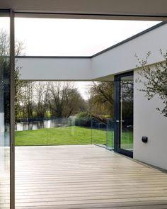 Narula House raised on stilts over River Thames flood zone British Architecture, London Architecture, Flooded House, Raised House, Solar Shades, Flood Zone, Interior Stairs, Timber Flooring, River Thames