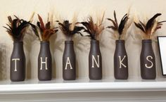 I made these with Starbucks bottles, brown spray paint and vinyl letters from my circuit :)