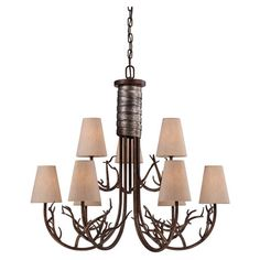 Pasadena Chandelier  Cast a stylish glow over your foyer or dining room decor with this lovely chandelier, showcasing silver-hued wrapped details, branch-inspired accents, and na...