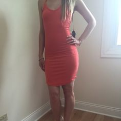 Coral Summer Dress Lightweight soft summer dress with spaghetti straps. Open back.                                           Size Small length 37in Waist stretches to about 16in Bust 13.5in.                                                        Size Medium length 38in Waist stretches to to about 17in Bust 14.5in.  ALL MEASUREMENTS ARE TAKEN LAYING FLAT. Dresses Mini