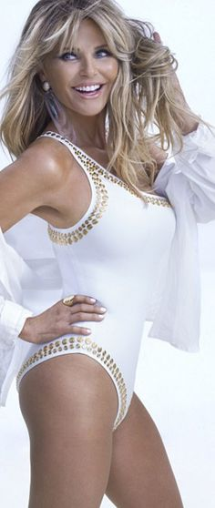 Who made Christie Brinkley's white one shoulder swimwear?