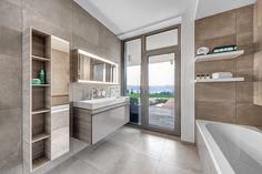 Do koupelny zvolili tradiční materiály – italskou keramickou dlažbu a obklady ABK Docks, nábytek a sanita jsou z řady Citterio od značky Keramag Design - ProŽeny.cz