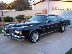 From the seller's description: This is a Triple Black 1976 Pontiac Grand Prix SJ with Original Black Paint, Black Cabriolet Top, and Black Leather Interior. This vehicle has original/actual miles. The vehicle is in. Classic Cars Usa, Counting Cars, Cool Old Cars, Interior Sliding Barn Doors, Pontiac Cars, Gm Car, Pontiac Bonneville, Pontiac Grand Prix, Old School Cars