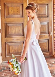 Indoor July wedding. Grey and Spanish orange themed. Dress and accessories from David's Bridal. Silk and fresh bouquet by P J Parkinson.