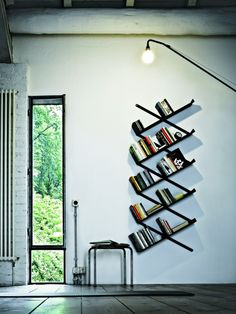 The booxx bookcase by Desalto has a steel plate frame and sheet metal shelves with 5 removable bookends in metal sheet. The panthograph frame allows a free bookcase position on the wall, to satisfy aesthetics or space required. Creative Bookshelves, Bookshelf Design, Modern Bookshelf, Metal Bookcase, Bookshelf Ideas, Cheap Bookshelves, Metal Shelves, Wall Storage, Cabinet Storage