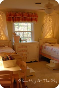 Love the look of the twinkle lights over the beds, but um, fire hazard?? Who does that in their kid's room?!