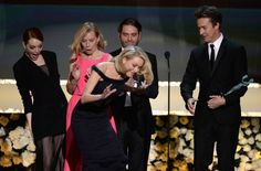 Pin for Later: 27 SAG Awards Pictures You'll Want to See STAT  Emma Stone nearly tripped Naomi Watts on stage as they picked up the statue for Birdman.