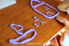 Use broken crayon pieces to make your own crayon play dough. This activity goes along with the book Harold and the Purple Crayon, part of the Preschool Book Club series.