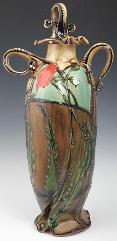 Carol Long draws influence from plant and animal life and is fascinated by the small complexities of the micro aspects of nature. Her work continues to evolve as she experiments with new ways of expressing the tiny beautiful intrinsic qualities of nature that we often take for granted. - Poppy Lidded Jar::28 x 12.5