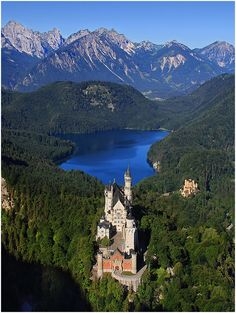 Neuschwanstein Castle in Bavaria, Germany. It was comissioned by King Ludvig II, the mad King of Bavaria. The palace served as a model for the Sleeping Beauty's Castle of Disneyland and became a location for films such as Helmut Käutner's Ludwig II (1955), Luchino Visconti's Ludwig (1972) and Chitty Chitty Bang Bang (1968).