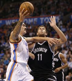 Oklahoma City's Steven Adams (12) goes past Brooklyn's Brook Lopez (11) during an NBA basketball game between the Oklahoma City Thunder and the Brooklyn Nets at Chesapeake Energy Arena on Wednesday, Nov. 25, 2015. Photo by Bryan Terry, The Oklahoman