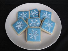 Sugar cookies with royal icing and edible pearl mist.