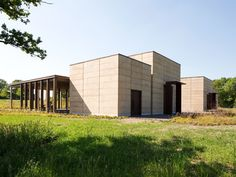 Waugh Thistleton has added a pair of new prayer halls to a Jewish cemetery in Hertfordshire, which features rammed-earth walls. Concrete Architecture, Sustainable Architecture, Rammed Earth Wall, Black Granite, Rural Area, Affordable Housing, Brutalist, New Construction, Innovation Design