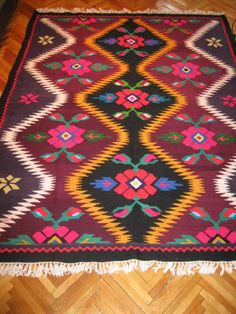 Beautiful antique traditional Romanian woven wool carpet / rug with both floral and geometrical pattern. size cm dyed with organic colors, do not wash with hot water Very beautiful condition for its age. Wool Carpet, Rugs On Carpet, Folk Art Flowers, Traditional Rugs, Woven Rug, Deco, Bohemian Rug, Hand Weaving, Antiques