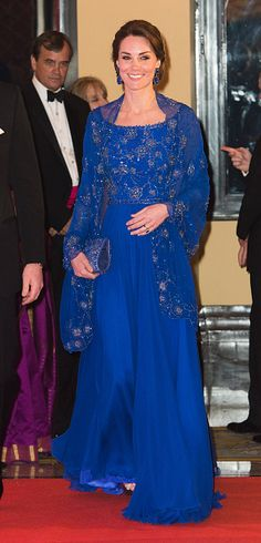 Kate Middleton's Most Romantic Outfits - Kate Middleton Style - APRIL 2016 - During a tour of India, Kate wore this gorgeous royal blue gown with a matching shawl—both designs that were beaded in India. When the shawl came off, Kate showed off the dress's design, which featured sheer sleeves and a neckline that displayed her collarbone. Find more of Kate Middleton's best outfits at redbookmag.com.