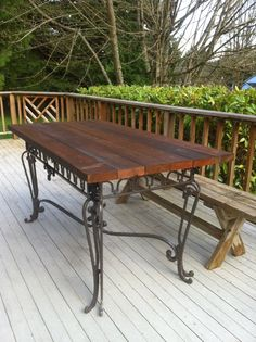 """Quick and easy table made from a salvaged iron base and a few old 2""""x6"""" from a house demo."""