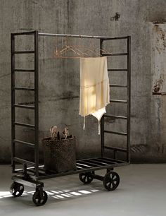 industrial clothing rack on wheels. Decor, Industrial Decor, Clothing Rack, Interior, Home Furnishings, Home Decor, Industrial Interiors, Interior Design, Furniture Design