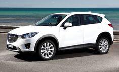 White Mazda CX-5 near the ocean Zo een hebben we nu (even) teleen gekregen , Super Auto