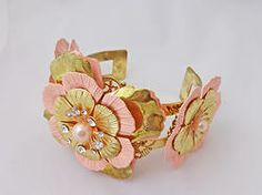 $12.00 - Flower cuff. Pretty flower cuff bracelet in gold-tone color with PINK accents and a faux pearl. This cuff is adjustable so one size fits all. #PINKBracelets #PINK #Bracelets #PINKPixie #Nonprofit    All of our proceeds go to educating women in crisis. www.pinkpixie.org