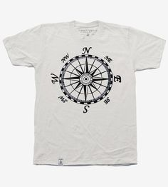 Relied on even in modern times for navigating the sea and sky, the compass is a symbol of travel, trailblazing and adventure. This organic cotton tee features one printed extra large on the front or back, the mariner's compass illustrated in the traditional 48-point design.