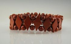 The bracelet measures wide and the diamond shape beads are x with 6 mm beads in between. Some natural external flaws. One of a Kind Artisan Jewelry Made in the USA with Free Domestic Shipping! Gemstone Bracelets, Handmade Bracelets, Sell On Etsy, My Etsy Shop, Selling Handmade Items, Handmade Products, Red Jasper, Beautiful Gifts, Etsy Jewelry