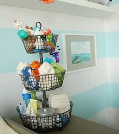 Organize baby's nursery in a unique way. Might be a good use of small space on changing table