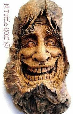 """""""Tickle Me Timbers"""" This slaphappy spirit measures 5 inches tall and just over 2¾ inches across his widest point. Signed and dated: N. Tuttle 12/23/13"""