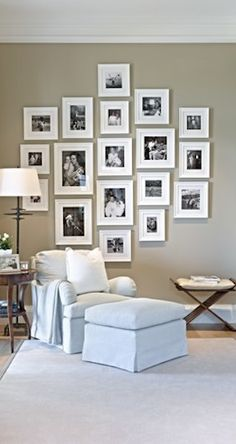 The graphic compilation of white picture frames holding black and white family photos elevates this bedroom sitting area to another level. ------------------- #picture #frames #gallery #wall #bedroom #diy