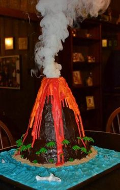 New science party cale erupting volcano ideas Luau Birthday, Dinosaur Birthday Party, Birthday Cake, Birthday Parties, Sheldon The Tiny Dinosaur, Tiki Party, Luau Party, Piniata Cake, Volcano Projects