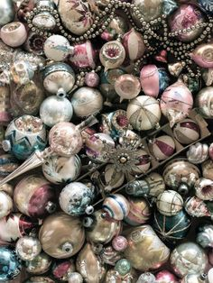 Lots of vintage sparkle!    Mercury glass ornaments and tree toppers.