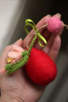 For my felted Easter Egg I used needle felted techniques and 100% pure Bulgarian wool.I dye the wool myself to achieve the right colors. My Easter Egg ornament has soft pink blossom, ribbon and felted ball.  The Easter Egg will make you feel surrounded by love.Just hang it up around