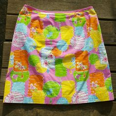 Lilly Pulitzer Chinese Lantern skirt size 10 Colorful Lilly Pulitzer skirt size 10. Zips in back and has a cute hidden pocket. Measurements laying flat are waist 15 1/4, widest part of hip measures 20 1/4, and length is approximately 20 inches. Lilly Pulitzer Skirts