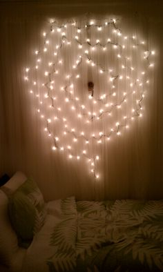 Rather then keeping the christmas lights stored up in the closet i wall art and soft lighting for the bedroom i took my extra christmas lights and aloadofball Image collections