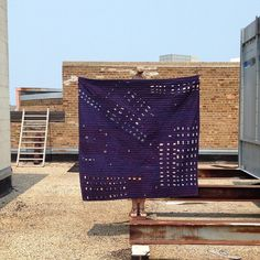 Artist Heidi Parkes with her 'Night Flight no. 2' quilt in Milwaukee, WI. #quilt #handquilted