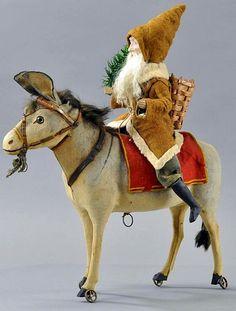 Antique Santa on Donkey With Wheels Toy.