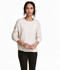 Khaki green melange. Oversized sweater in a soft, fine knit with wool content. Dropped shoulders, ribbing at neckline, cuffs, and hem, and slightly longer